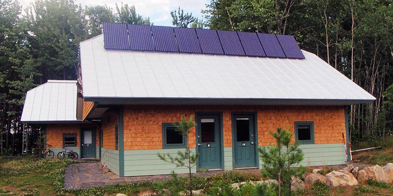 Roof-mounted solar panel array at the huts